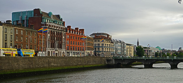 6/24  Dublin, Ireland.  The River Liffey cuts right through the heart of the city.  The rainbow flags are up because it was Pride Parade Day.