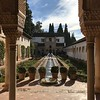 Exploring the gardens of the Alhambra palace in Granada<br /> <br /> Spain Cultural Journey