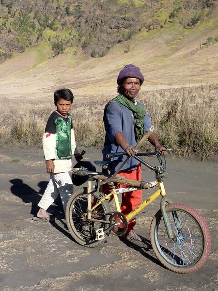 Father & son take a slower route through the savanna back to their remote Tenggerese village.