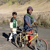 Father & son take a slower route through the savanna back to their remote Tenggerese village.