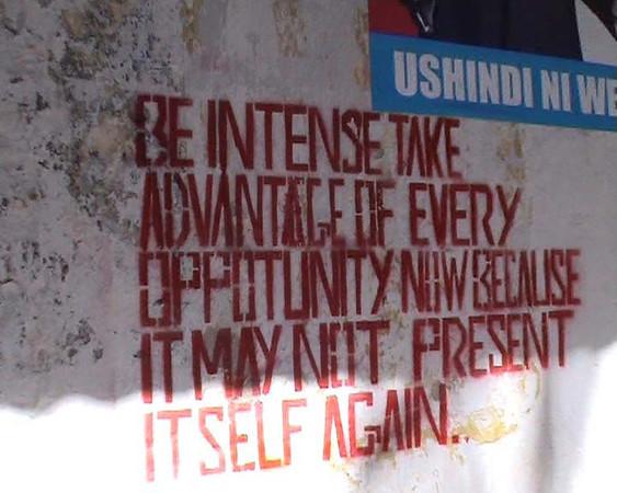 Words of wisdom on the market wall in Zanzibar.