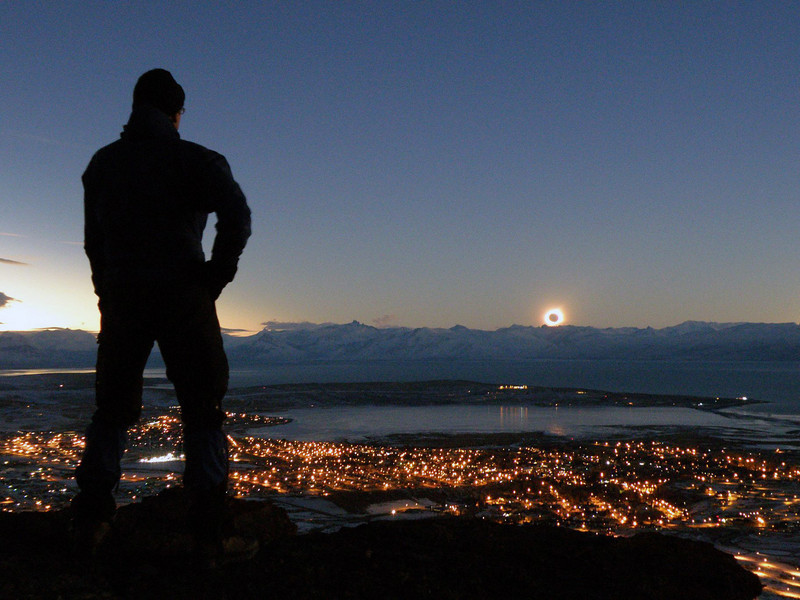 The total solar eclipse of 11 July 2010 seen from atop the Cerro Huyliche plateau, with the town of El Calafate and Lago Argentino below, in Patagonia, Argentina