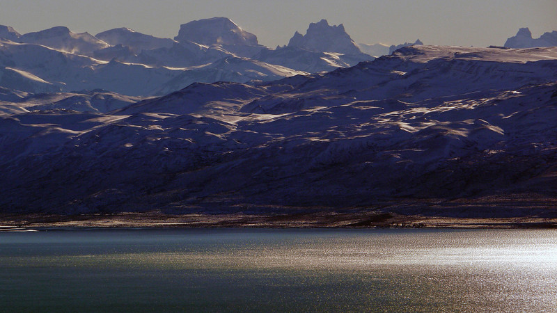 The crests ot he Andes, seen from atop the Cerro Huyliche plateau, overlooking Lago Argentino in Patagonia, Argentina