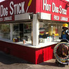 "The ""Hula Hoop Guy"" takes a break at ""Hot Dog Stick"" at the Santa Monica Pier"