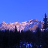 The Canadian Rockies rise above the forest in Lake Louise.