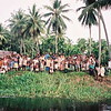 Friendly villagers wave good bye to our boat on the upper Sepik river, Papua New Guinea.
