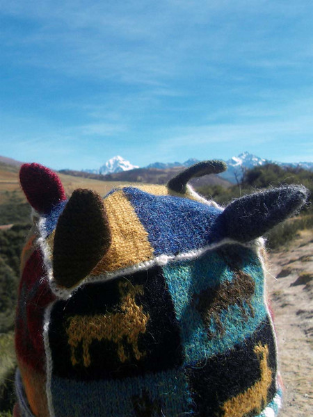 "Flip and his ""sacred four peaks"" hat survey the actual four sacred peaks in the Urubamba valley near Moray in Peru."