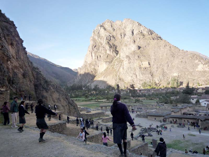 Schoolgirls practice their pageant steps on the ancient terraced slopes of Olantaytambo, Peru.
