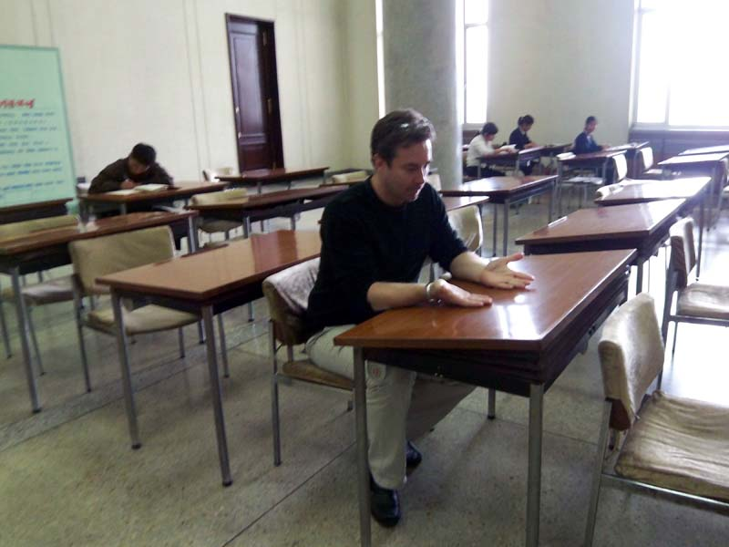 Flip doesn't know what to study at the public library in Pyongyang, Democratic People's Republic of Korea (north).