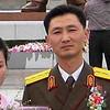 A somber groom in Pyongyang, Democratic People's republic of Korea (north).