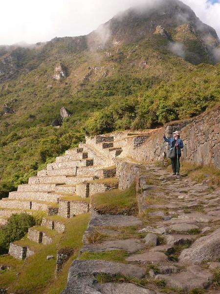 Avid trekkers on the path to the sun gate at Machu Picchu, Peru.