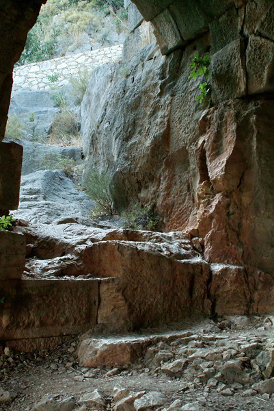 Collapsed rock are under the amphitheater on the way up to the hillside temple tombs in Myra, along the Lycian Way, Turkey