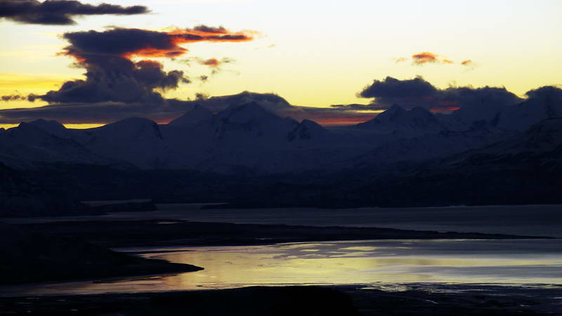 Post eclipse sunset seen from atop the Cerro Huyliche plateau, overlooking Lago Argentino in Patagonia, Argentina