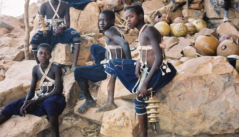 Young boys wait out the obligatory period after circumcision in the mountains above Songo