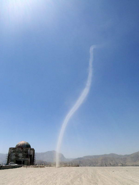 A dust devil miraculously descends from the sky near an abandoned hilltop mosque in Kabul, Afghanistan.