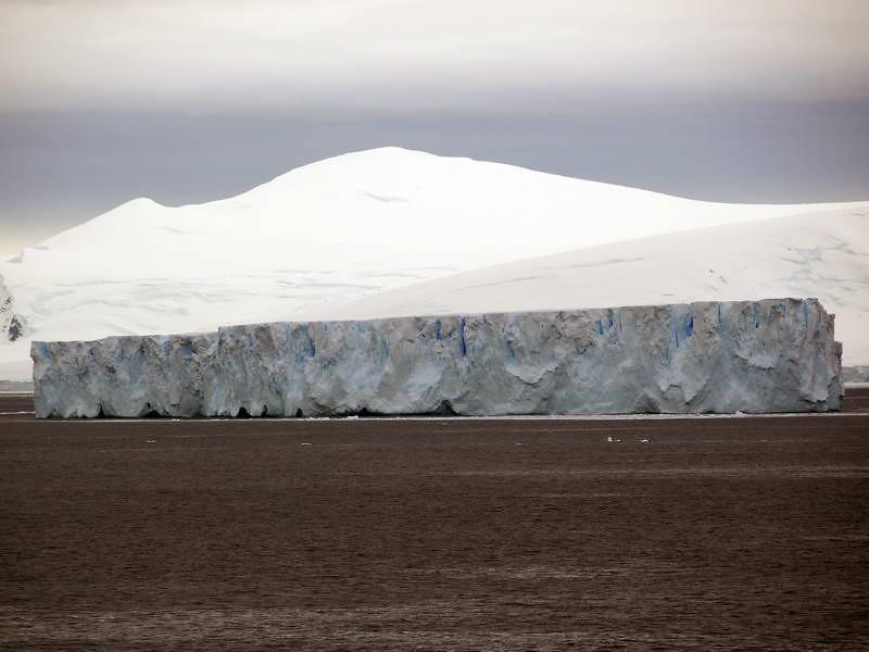 "Massive tabular iceberg, (a ""Borg"" ship), in the bay at Detaille Island, Antarctic peninsula"