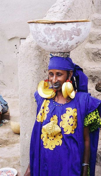 Wealthy Fulani woman displays her stature in the size of her golden earrings in Burkina Faso, West Africa