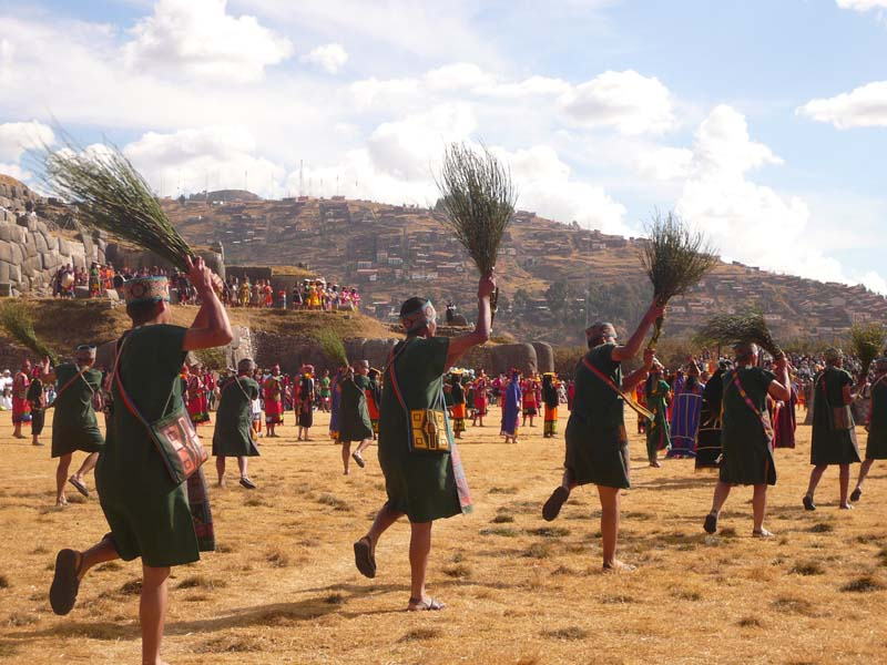 The sweepers come through again during the Inti Raymi celebrations in Sacsayhuanman near Cuzco Peru.