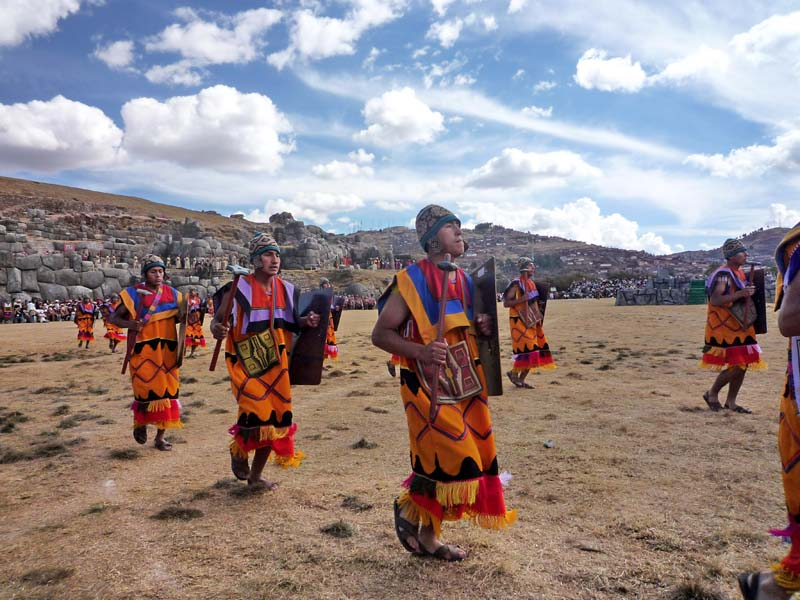 Rhythmic dancers during the Inti Raymi celebrations in Sacsayhuanman near Cuzco Peru.