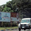 Roadside billboards keep the populace up to date with important government propaganda near of Monrovia Liberia.