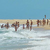 Locals frolic in the surf near Trancoso, Brasil
