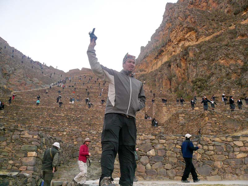 Flip stands triumphant on the ancient terraced slopes of Olantaytambo, Peru.