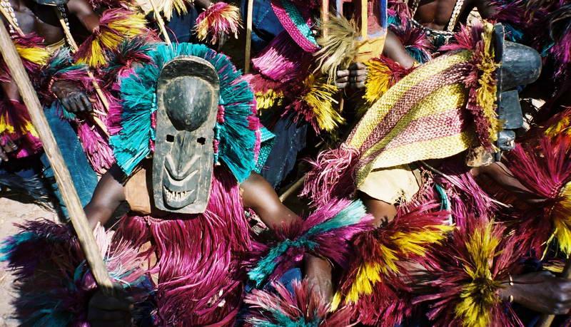 Dogon dance masks celebrate in Tirelli village, Mali West Africa