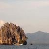 Limestone outcrops dot the seascape near El Nido, Palawnan, Philippines.