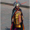 A lone high priest staggers about the city square during the parade in Cuzco Peru for Inti Raymi.