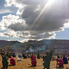 The sun shines ominously upon the ancient rituals at Sacsayhuanman during the Inti Raymi celebration in Cuzco, Peru.