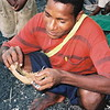 Coconut husk inspection on the beach in Kavieng, Papua New Guinea.