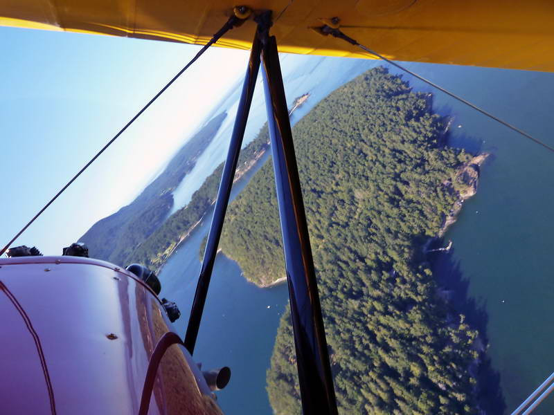 Overhead view of Orcas island from a historic b-plane in northwest Washington state