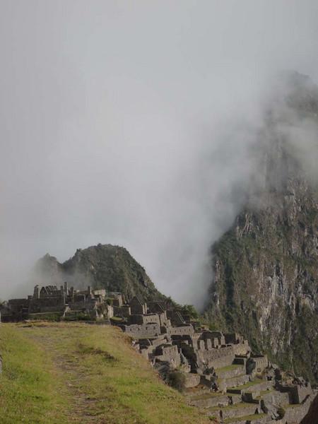 Morning mist rolls over the ancient ruins of Machu Picchu, Peru.