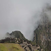 Morning mist rolls over the ancient ruins of Machu Picchu, Peru.