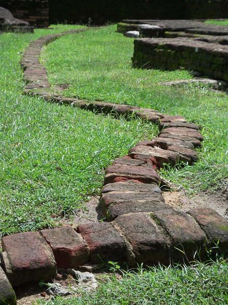 Serpentine temple foundation remains in rural Sri Lanka.
