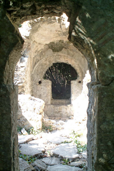 Feature doorway tucked in the jungle overgrowth along the Lycian way, at Olympos, Turkey.