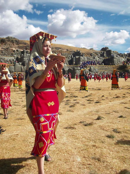 Maidens bringing offerings during the Inti Raymi celebrations in Sacsayhuanman near Cuzco Peru.