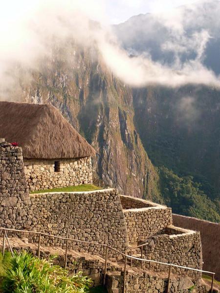 Upper buildings above the main plateau of Machu Picchu, Peru.