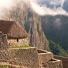Upper buildings above the main plateau of Machu Picchu, Peru.