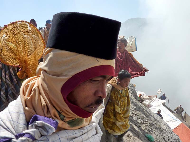 A local prepares to toss his offering to the Gods of Mt Bromo, East Java Indonesia