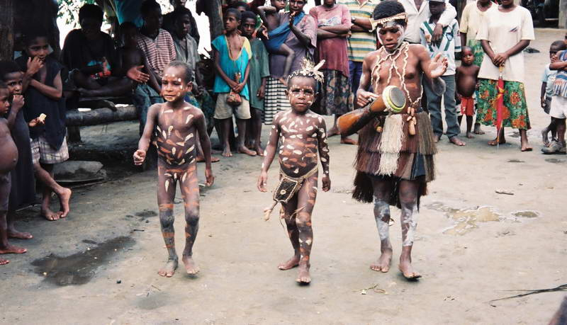 """""""Jive Babies"""" celebrate with their elders in a village mask dance celebration along the Sepik river in Papua New Guinea"""