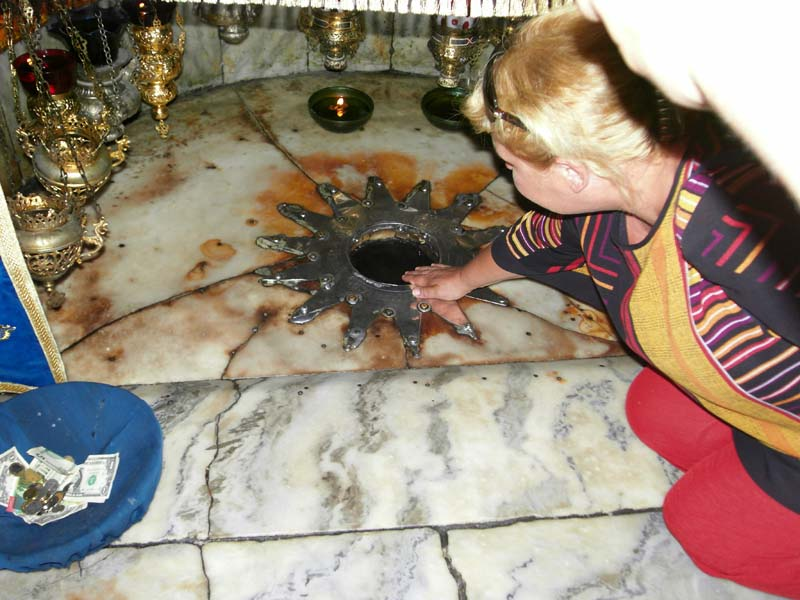 Bronze star marking the exact spot where the baby Jesus was born in the basement of the holy Church of the Nativity in Bethlehem, Palestine.