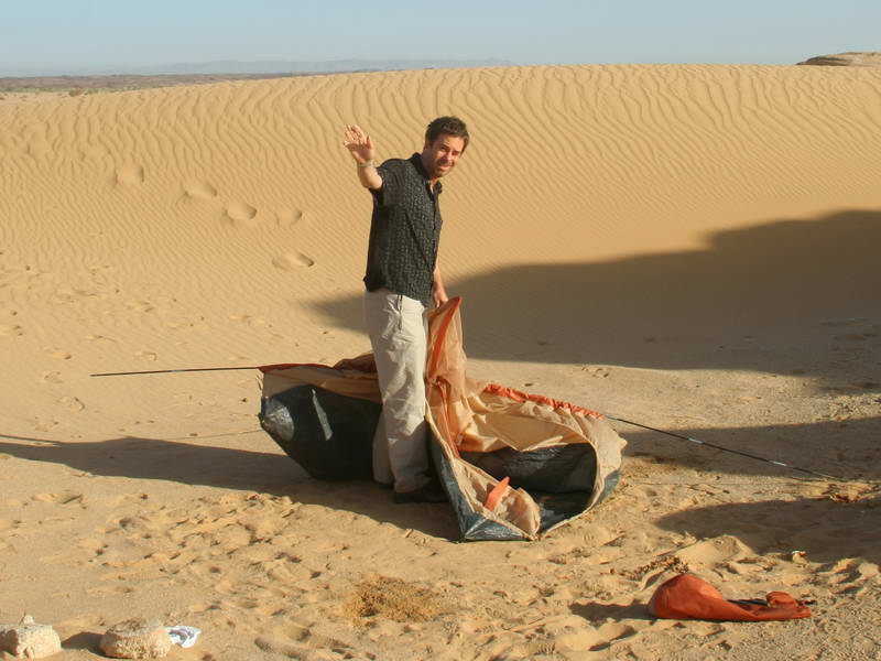 Setting up tents in the Tenere desert, Niger.