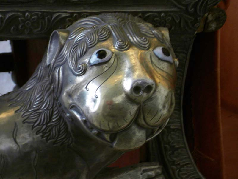 Detail of a lion embellishment on a royal carriage at the palace in Jodphur, Rajastan India.