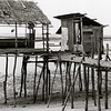 Abandoned water village at low tide in Nagoya, Batam, Indonesia.
