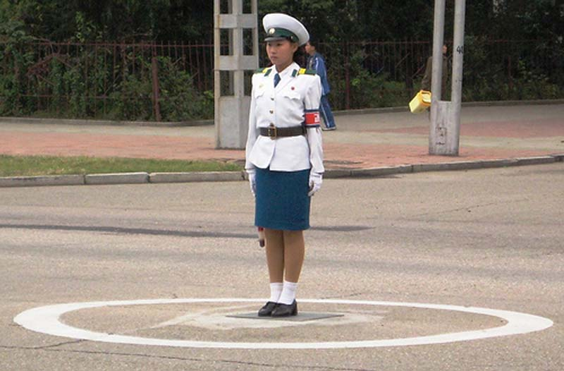 Synchronized traffic cop performs her routine centrestage in Pyongyang, North Korea.