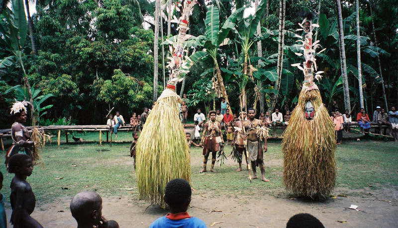 The Protector masks dance to herald our arrival on the upper Sepik river, Papua New Guinea.