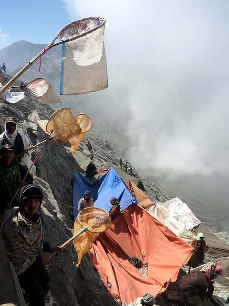 """Eager """"freelancers"""" roam the inner hillsdie with nets and bags on long poles, hoping to catch far flung items first!"""