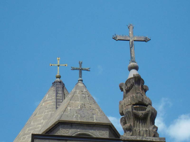 15th century orthodox crosses adorn the rooftops of a cathedral in Yerevan, Armenia.