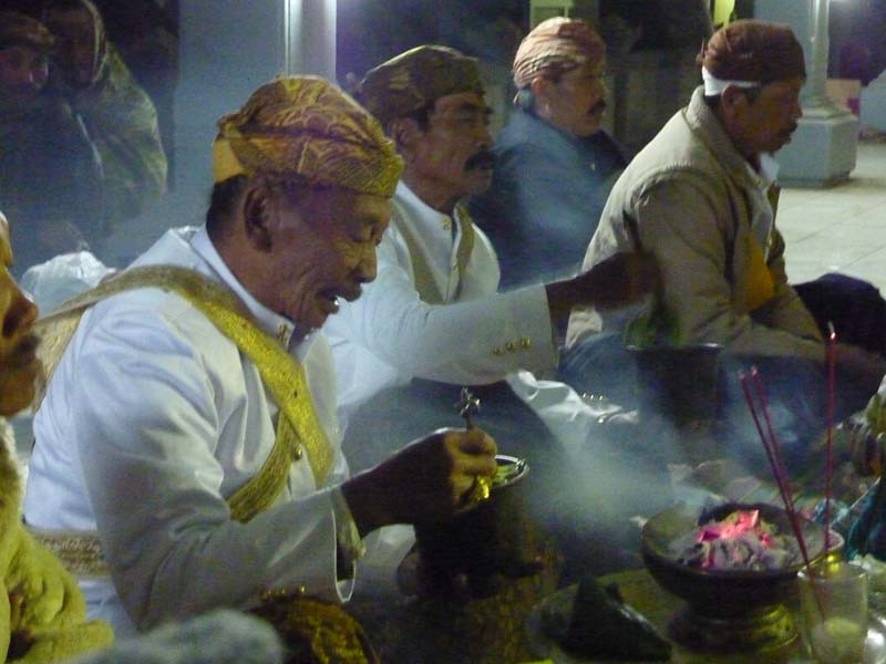 A priest in the temple blesses items for sacrifice during Yadnya Kasada.